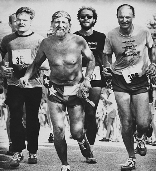 <div class='meta'><div class='origin-logo' data-origin='AP'></div><span class='caption-text' data-credit='AP Photo/Daemmrich'>Willie Nelson crosses the finish line at the first annual Willie Nelson distance classic on Sunday, June 15, 1980 near Lake Travis in Austin, Texas.</span></div>