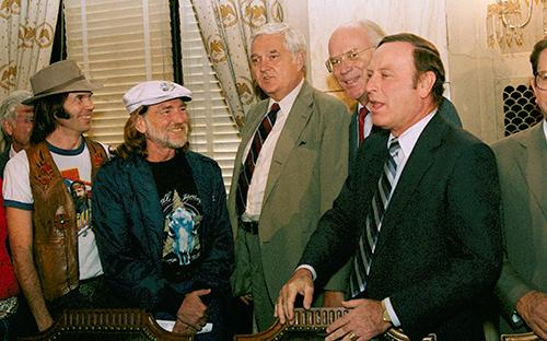 <div class='meta'><div class='origin-logo' data-origin='AP'></div><span class='caption-text' data-credit='AP Photo/Scott Stewart'>Willie Nelson and Neil Young meet with members of the Senate Agriculture Committee on  September 20, 1985 in an attempt to lobby for legislation that would boost farm income.</span></div>