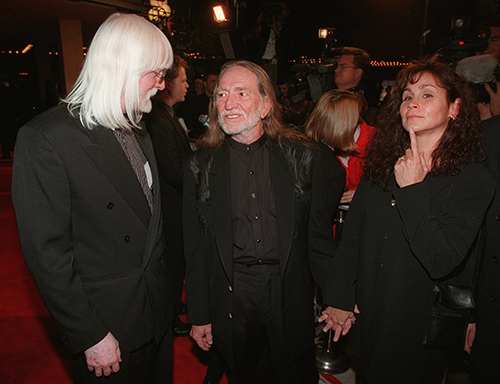 <div class='meta'><div class='origin-logo' data-origin='AP'></div><span class='caption-text' data-credit='AP Photo/Chris Pizzello'>Country singer Willie Nelson, center, and his wife Annie mingle with rock and roll guitarist Edgar Winter at the premiere of the film &#34;Wag the Dog,&#34; Wednesday, Dec. 17, 1997.</span></div>