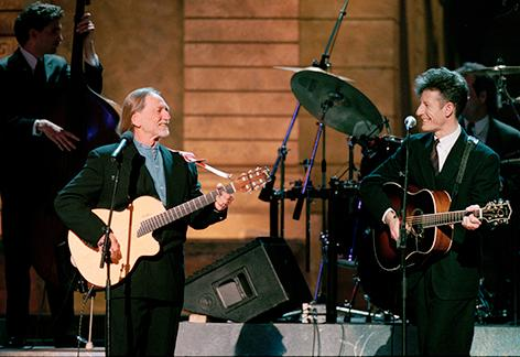 <div class='meta'><div class='origin-logo' data-origin='AP'></div><span class='caption-text' data-credit='AP Photo/Ron Frehm'>Singers Willie Nelson and Lyle Lovett, right, perform with Lovett's Large Band at the annual ESPY awards show at New York's Radio City Music Hall, on February 13, 1995.</span></div>