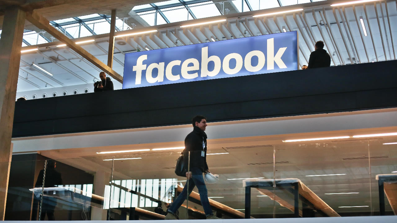 Facebook logo is displayed in a start-up companies gathering at Paris' Station F, in Paris, Tuesday, Jan. 17, 2017.