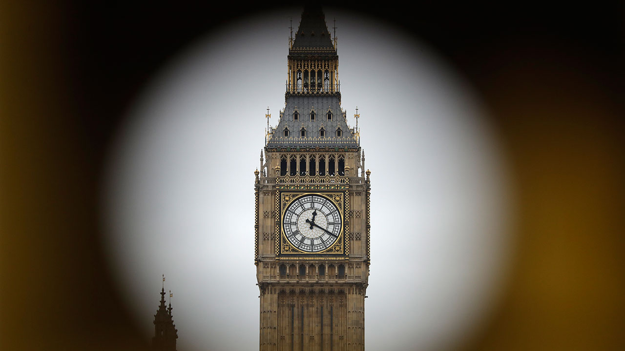 "The Elizabeth Tower at Houses of Parliament containing the bell know as ""Big Ben"" are framed by a hole in central London, Wednesday, March 29, 2017."