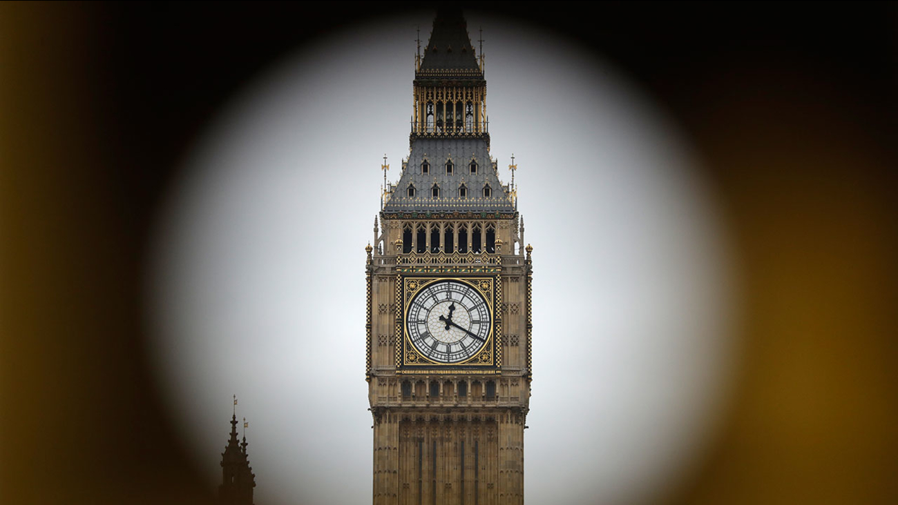 """The Elizabeth Tower at Houses of Parliament containing the bell know as """"Big Ben"""" are framed by a hole in central London, Wednesday, March 29, 2017."""
