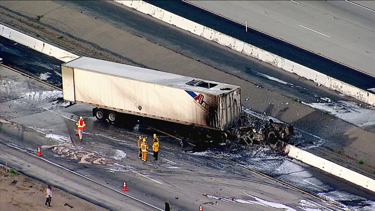 The wreckage of a big rig is seen after a fiery crash on the 15 Freeway in Apple Valley on Thursday, March 30, 2017.