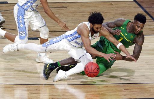 "<div class=""meta image-caption""><div class=""origin-logo origin-image none""><span>none</span></div><span class=""caption-text"">Oregon's Jordan Bell (1) chases a loose ball against North Carolina's Joel Berry II (AP Photo/Matt York)</span></div>"