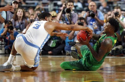 "<div class=""meta image-caption""><div class=""origin-logo origin-image none""><span>none</span></div><span class=""caption-text"">North Carolina's Kennedy Meeks (3) battles for the possession of the ball against Oregon's Jordan Bell  (AP Photo/Charlie Neibergall)</span></div>"