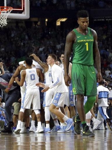 "<div class=""meta image-caption""><div class=""origin-logo origin-image none""><span>none</span></div><span class=""caption-text"">Oregon's Jordan Bell (1) walks off the court as North Carolina players celebrate (AP Photo/David J. Phillip)</span></div>"