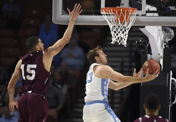 """<div class=""""meta image-caption""""><div class=""""origin-logo origin-image ap""""><span>AP</span></div><span class=""""caption-text"""">North Carolina's Kanler Coker (13) drives past Stephan Bennett (15) during the second half in a first-round game of the NCAA men's college basketball tournament (AP Photo/Rainier Ehrhardt)</span></div>"""