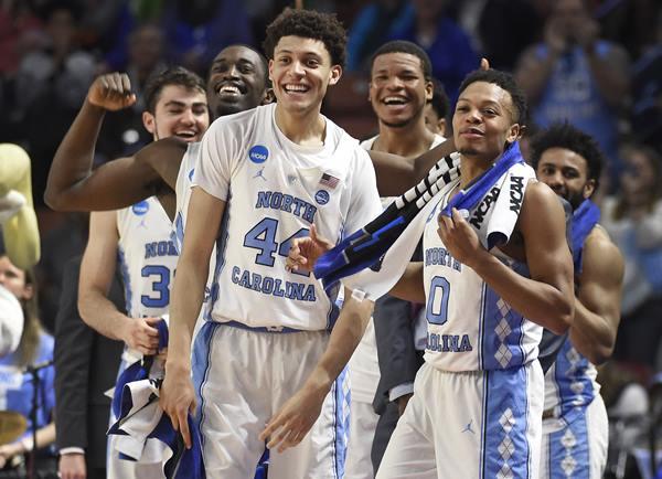 "<div class=""meta image-caption""><div class=""origin-logo origin-image ap""><span>AP</span></div><span class=""caption-text"">North Carolina players, from left, Luke Maye, Theo Pinson, Justin Jackson, Kennedy Meeks, Nate Britt and Joel Berry II react to a teammate's basket against Texas Southern (AP Photo/Rainier Ehrhardt)</span></div>"
