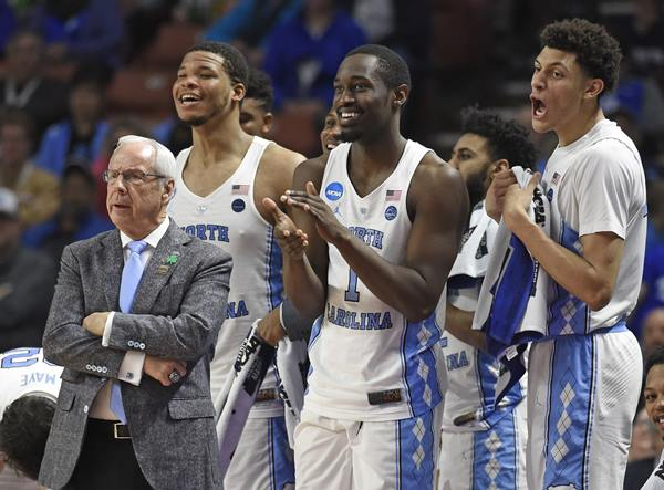 """<div class=""""meta image-caption""""><div class=""""origin-logo origin-image ap""""><span>AP</span></div><span class=""""caption-text"""">North Carolina head coach Roy Williams, left, and players Kennedy Meeks, Theo Pinson and Justin Jackson react during the second half against Texas Southern (AP Photo/Rainier Ehrhardt)</span></div>"""