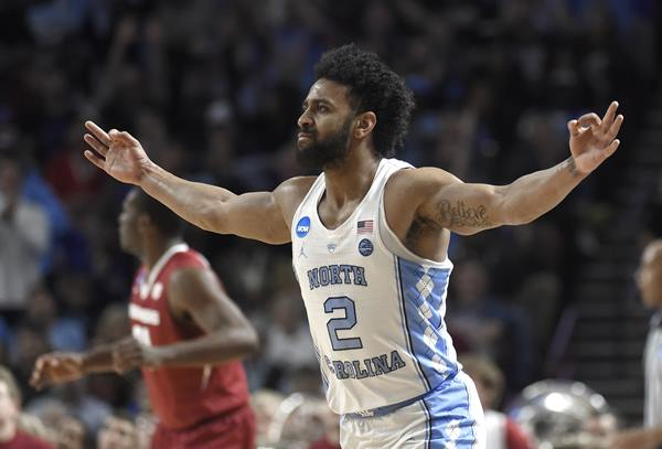 """<div class=""""meta image-caption""""><div class=""""origin-logo origin-image ap""""><span>AP</span></div><span class=""""caption-text"""">North Carolina's Joel Berry II (2) reacts after making a three-point basket against Arkansas during the first half in a second-round game (AP Photo/Rainier Ehrhardt)</span></div>"""