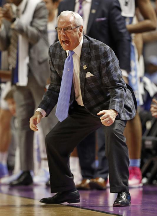 """<div class=""""meta image-caption""""><div class=""""origin-logo origin-image ap""""><span>AP</span></div><span class=""""caption-text"""">North Carolina head coach Roy Williams shouts to his team during the second half in a second-round game against Arkansas (AP Photo/Chuck Burton)</span></div>"""