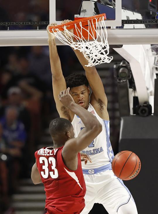 """<div class=""""meta image-caption""""><div class=""""origin-logo origin-image ap""""><span>AP</span></div><span class=""""caption-text"""">North Carolina's Isaiah Hicks (4) dunks against Arkansas' Moses Kingsley (33) during the second half in a second-round game (AP Photo/Chuck Burton)</span></div>"""
