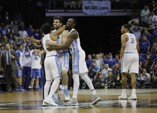 """<div class=""""meta image-caption""""><div class=""""origin-logo origin-image ap""""><span>AP</span></div><span class=""""caption-text"""">North Carolina forward Luke Maye, second from left, celebrates after shooting the winning basket against Kentucky in the second half of the South Regional final game (AP Photo/Mark Humphrey)</span></div>"""