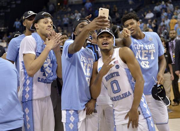 """<div class=""""meta image-caption""""><div class=""""origin-logo origin-image ap""""><span>AP</span></div><span class=""""caption-text"""">North Carolina players celebrate after beating Kentucky in the South Regional final game in the NCAA college basketball tournament (AP Photo/Brandon Dil)</span></div>"""