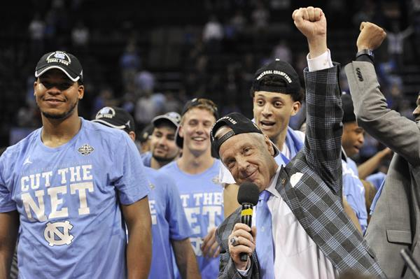 """<div class=""""meta image-caption""""><div class=""""origin-logo origin-image ap""""><span>AP</span></div><span class=""""caption-text"""">North Carolina head coach Roy Williams celebrates with his team after beating Kentucky in the South Regional final game in the NCAA college basketball tournament (AP Photo/Brandon Dill)</span></div>"""