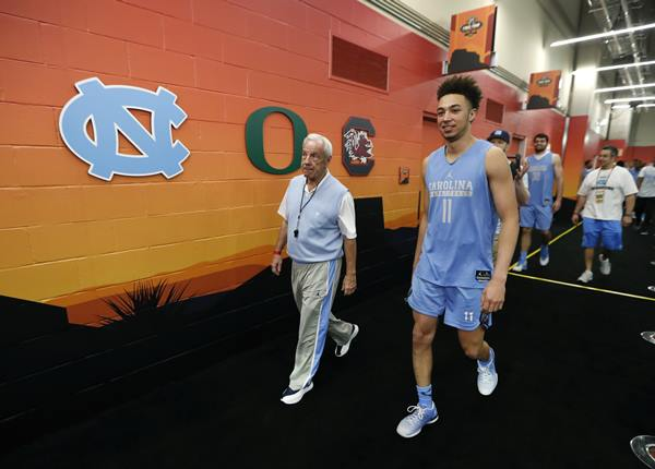 """<div class=""""meta image-caption""""><div class=""""origin-logo origin-image ap""""><span>AP</span></div><span class=""""caption-text"""">North Carolina head coach Roy Williams walks to the court with North Carolina forward Shea Rush, right, before a practice session for their NCAA Final Four tournament (AP Photo/Charlie Neibergall)</span></div>"""