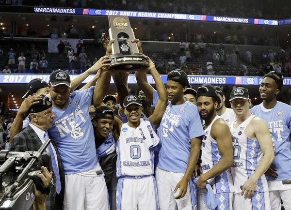 """<div class=""""meta image-caption""""><div class=""""origin-logo origin-image ap""""><span>AP</span></div><span class=""""caption-text"""">North Carolina players and coaches celebrate after beating Kentucky 75-73 in the South Regional final game (AP Photo/Mark Humphrey)</span></div>"""