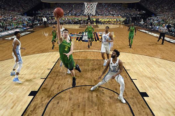 """<div class=""""meta image-caption""""><div class=""""origin-logo origin-image ap""""><span>AP</span></div><span class=""""caption-text"""">Oregon's Payton Pritchard (3) goes up for a shot during the first half in the semifinals of the Final Four NCAA college basketball tournament against North Carolina (AP Photo/Chris Steppig, Pool)</span></div>"""