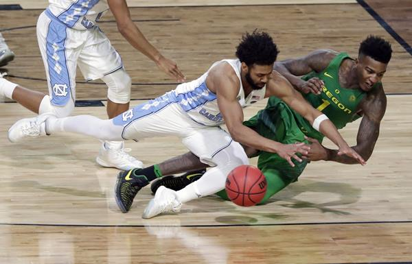 """<div class=""""meta image-caption""""><div class=""""origin-logo origin-image ap""""><span>AP</span></div><span class=""""caption-text"""">Oregon's Jordan Bell (1) chases a loose ball against North Carolina's Joel Berry II during the second half in the semifinals of the Final Four NCAA college basketball tournament (AP Photo/Matt York)</span></div>"""