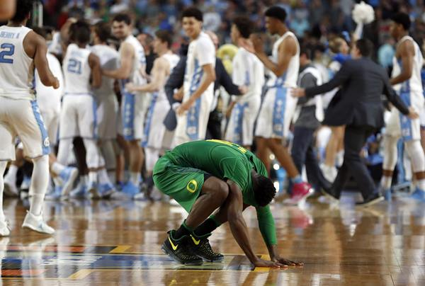 """<div class=""""meta image-caption""""><div class=""""origin-logo origin-image ap""""><span>AP</span></div><span class=""""caption-text"""">Oregon's Dylan Ennis reacts after the semifinals of the Final Four NCAA college basketball tournament against North Carolina (AP Photo/Charlie Neibergall)</span></div>"""