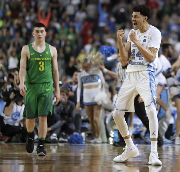 """<div class=""""meta image-caption""""><div class=""""origin-logo origin-image ap""""><span>AP</span></div><span class=""""caption-text"""">North Carolina forward Justin Jackson (44) celebrates in front of Oregon guard Payton Pritchard (3) at the end of a semifinal in the Final Four NCAA college basketball tournament (AP Photo/Mark Humphrey)</span></div>"""