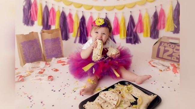 baby celebrates 1st birthday with taco bell themed photo shoot