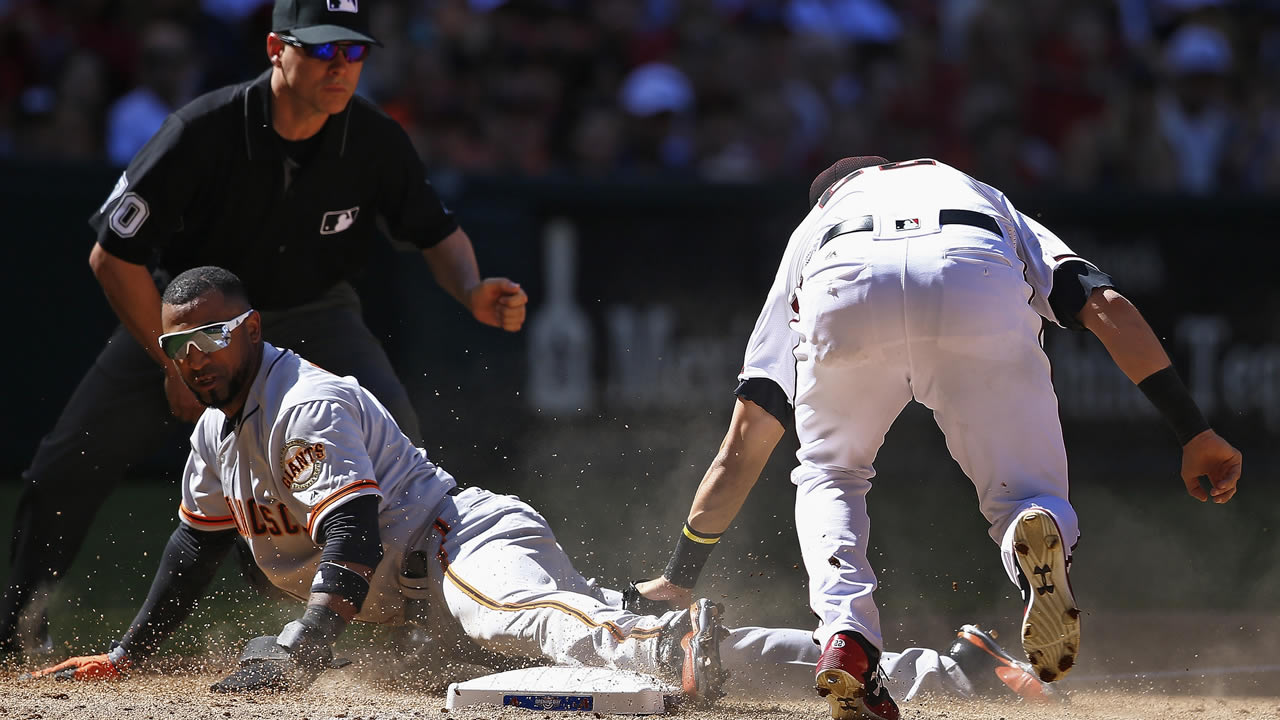 Diamondbacks' Jake Lamb tags out San Francisco Giants' Eduardo Nunez during the sixth inning of an opening day game on April 2, 2017, in Phoenix. (AP Photo/Ross D. Franklin)