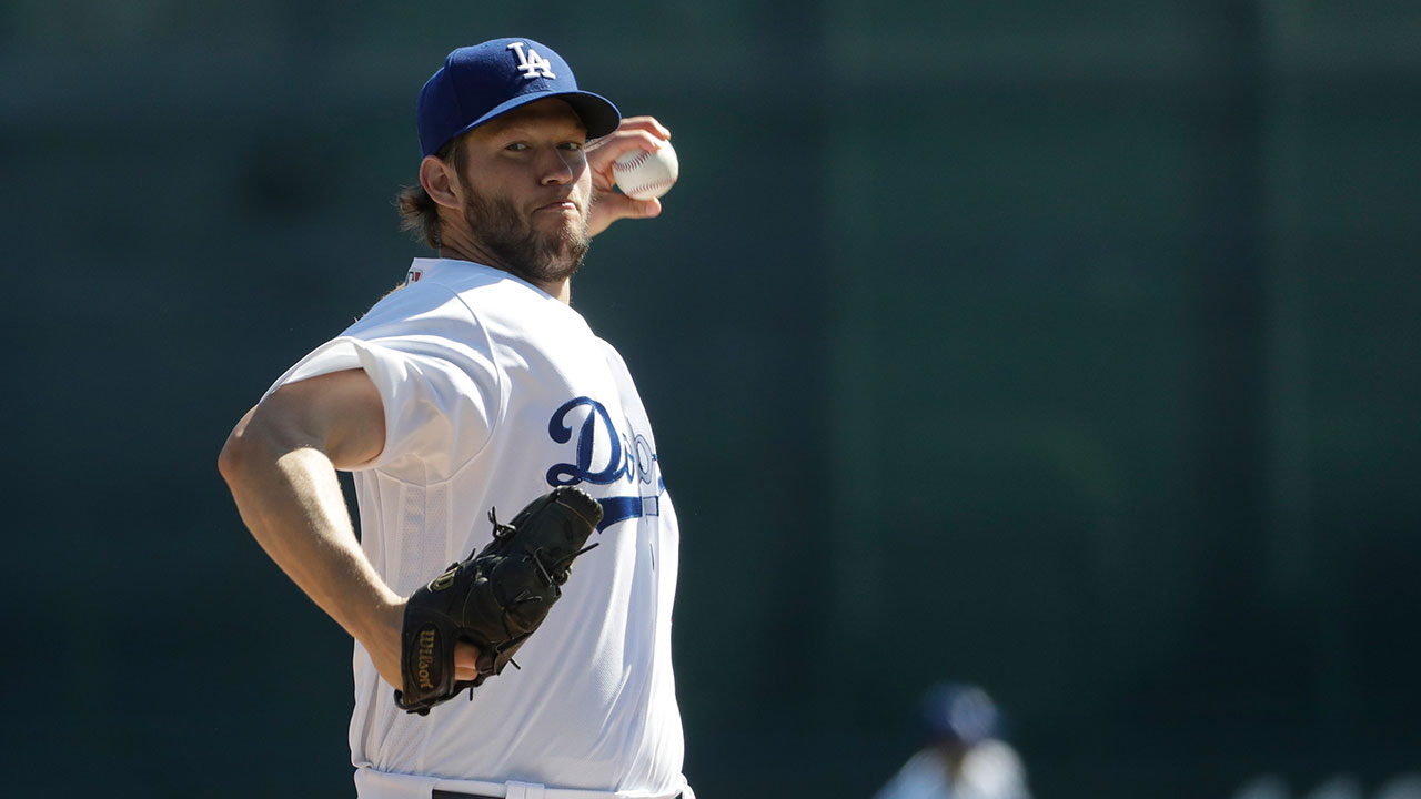 Dodgers pitcher Clayton Kershaw, pictured at a February spring-training game, is the highest-paid player in baseball this year while the team carries the league's highest payroll.