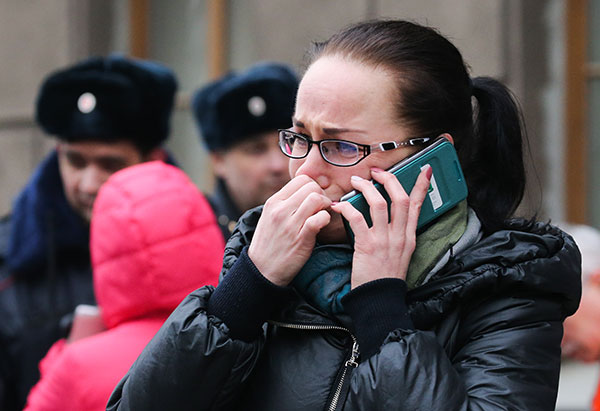 "<div class=""meta image-caption""><div class=""origin-logo origin-image none""><span>none</span></div><span class=""caption-text"">A woman uses a phone at the entrance to Tekhnologichesky Institut station of the St Petersburg metro in the aftermath of an explosion which occurred in a train on Monday. (Peter Kovalev\TASS via Getty Images)</span></div>"