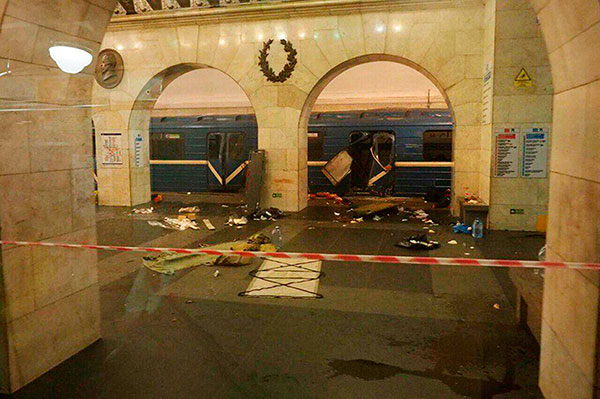 "<div class=""meta image-caption""><div class=""origin-logo origin-image none""><span>none</span></div><span class=""caption-text"">A subway train hit by a explosion stays at the Tekhnologichesky Institut subway station in St.Petersburg, Russia, Monday, April 3, 2017. (AP Photo/www.vk.com/spb_today via AP)</span></div>"