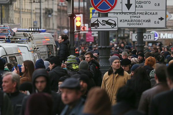 "<div class=""meta image-caption""><div class=""origin-logo origin-image none""><span>none</span></div><span class=""caption-text"">Locals near Tekhnologichesky Institut station of the St Petersburg metro in the aftermath of a blast that hit a train carriage between stations. (Alexander Demianchuk\TASS via Getty Images)</span></div>"