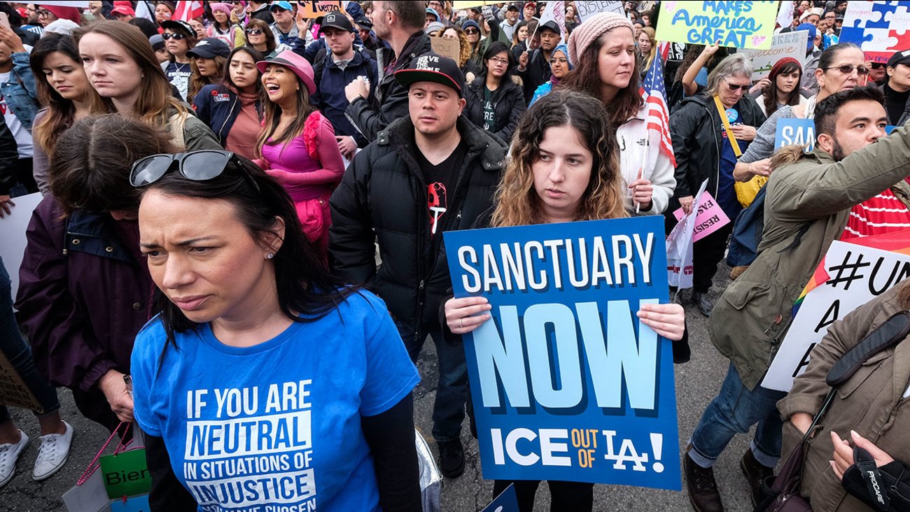 Thousands of people took part in a march in Los Angeles on Feb. 18, 2017 to protest President Trump's immigration policies and call for immigrants to be given sanctuary.