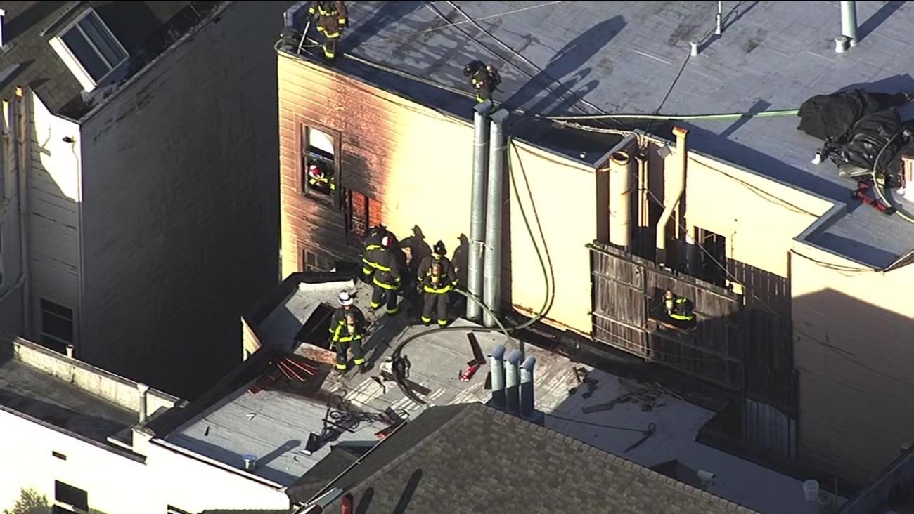 Firefighters battle a blaze in San Francisco's Haight-Ashbury neighborhood on Monday, April 3, 2017.