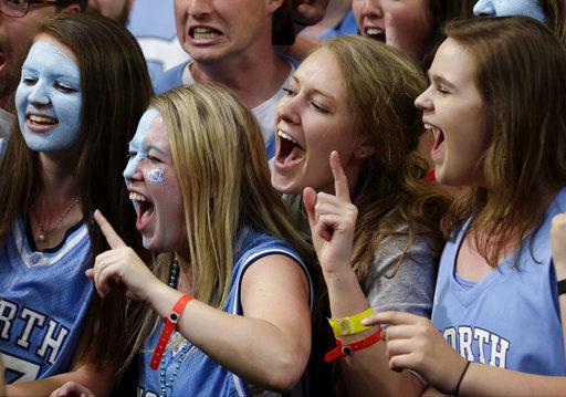 "<div class=""meta image-caption""><div class=""origin-logo origin-image none""><span>none</span></div><span class=""caption-text"">North Carolina fans cheer. (AP Photo/David J. Phillip)</span></div>"