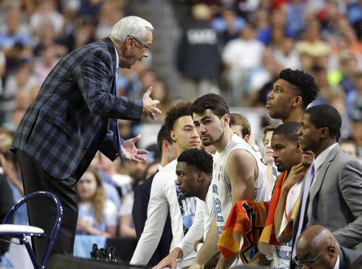 "<div class=""meta image-caption""><div class=""origin-logo origin-image none""><span>none</span></div><span class=""caption-text"">North Carolina head coach Roy Williams talks to his players. (AP Photo/Mark Humphrey)</span></div>"