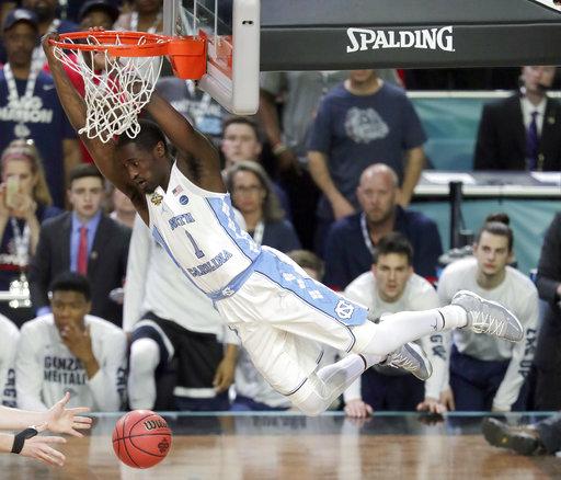 "<div class=""meta image-caption""><div class=""origin-logo origin-image none""><span>none</span></div><span class=""caption-text"">North Carolina's Theo Pinson (1) dunks. (AP Photo/Matt York)</span></div>"
