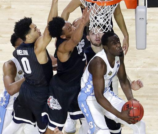 "<div class=""meta image-caption""><div class=""origin-logo origin-image none""><span>none</span></div><span class=""caption-text"">North Carolina's Theo Pinson (1) goes up for a shot against Gonzaga's defense. (AP Photo/David J. Phillip)</span></div>"