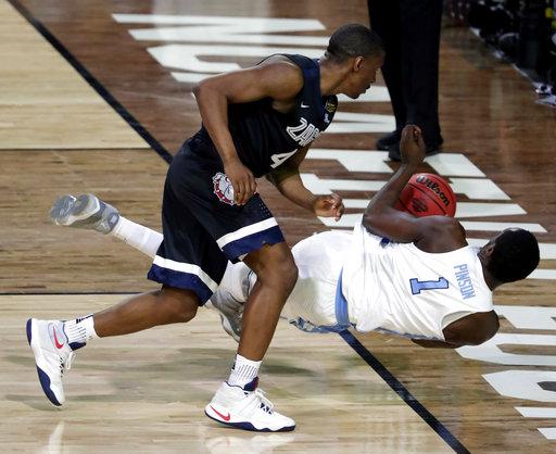 "<div class=""meta image-caption""><div class=""origin-logo origin-image none""><span>none</span></div><span class=""caption-text"">North Carolina's Theo Pinson (1) dives for a loose ball against Gonzaga's Jordan Mathews (4). (AP Photo/Matt York)</span></div>"