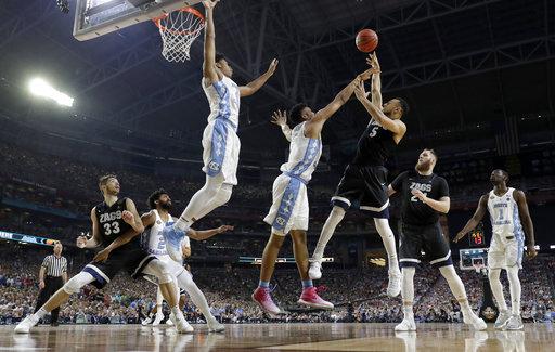 "<div class=""meta image-caption""><div class=""origin-logo origin-image none""><span>none</span></div><span class=""caption-text"">Gonzaga's Nigel Williams-Goss (5) takes a shot over North Carolina's Tony Bradley. (AP Photo/Mark Humphrey)</span></div>"