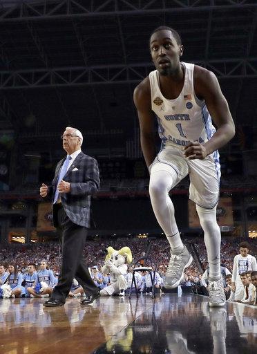 "<div class=""meta image-caption""><div class=""origin-logo origin-image none""><span>none</span></div><span class=""caption-text"">North Carolina's Theo Pinson (1) takes the court as head coach Roy Williams watches. (AP Photo/David J. Phillip)</span></div>"