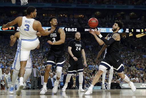 "<div class=""meta image-caption""><div class=""origin-logo origin-image none""><span>none</span></div><span class=""caption-text"">Gonzaga's Josh Perkins, right, grabs a rebound. (AP Photo/David J. Phillip)</span></div>"