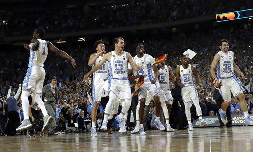 "<div class=""meta image-caption""><div class=""origin-logo origin-image none""><span>none</span></div><span class=""caption-text"">North Carolina players celebrate. (AP Photo/David J. Phillip)</span></div>"