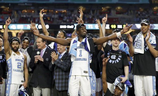 "<div class=""meta image-caption""><div class=""origin-logo origin-image none""><span>none</span></div><span class=""caption-text"">North Carolina's Theo Pinson (1) and the rest of the team celebrate. (AP Photo/David J. Phillip)</span></div>"
