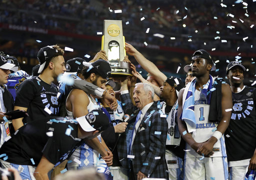 "<div class=""meta image-caption""><div class=""origin-logo origin-image none""><span>none</span></div><span class=""caption-text"">North Carolina head coach Roy Williams is interviewed as his team celebrates. (AP Photo/Mark Humphrey)</span></div>"