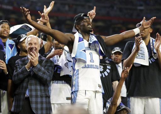 <div class='meta'><div class='origin-logo' data-origin='none'></div><span class='caption-text' data-credit=''>North Carolina's Theo Pinson (1) celerates with head coach Roy Williams and the rest of the players. (AP Photo/Mark Humphrey)</span></div>
