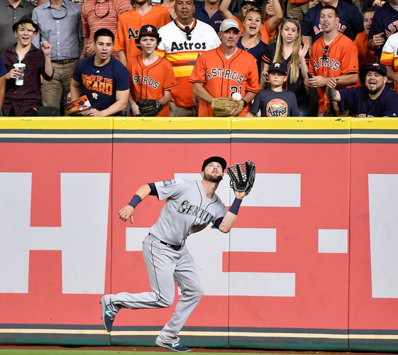 <div class='meta'><div class='origin-logo' data-origin='none'></div><span class='caption-text' data-credit='AP Photo/Eric Christian Smith'>Seattle Mariners center fielder Mitch Haniger catches the fly ball of Houston Astros' Alex Bregman in the third inning of the game.</span></div>