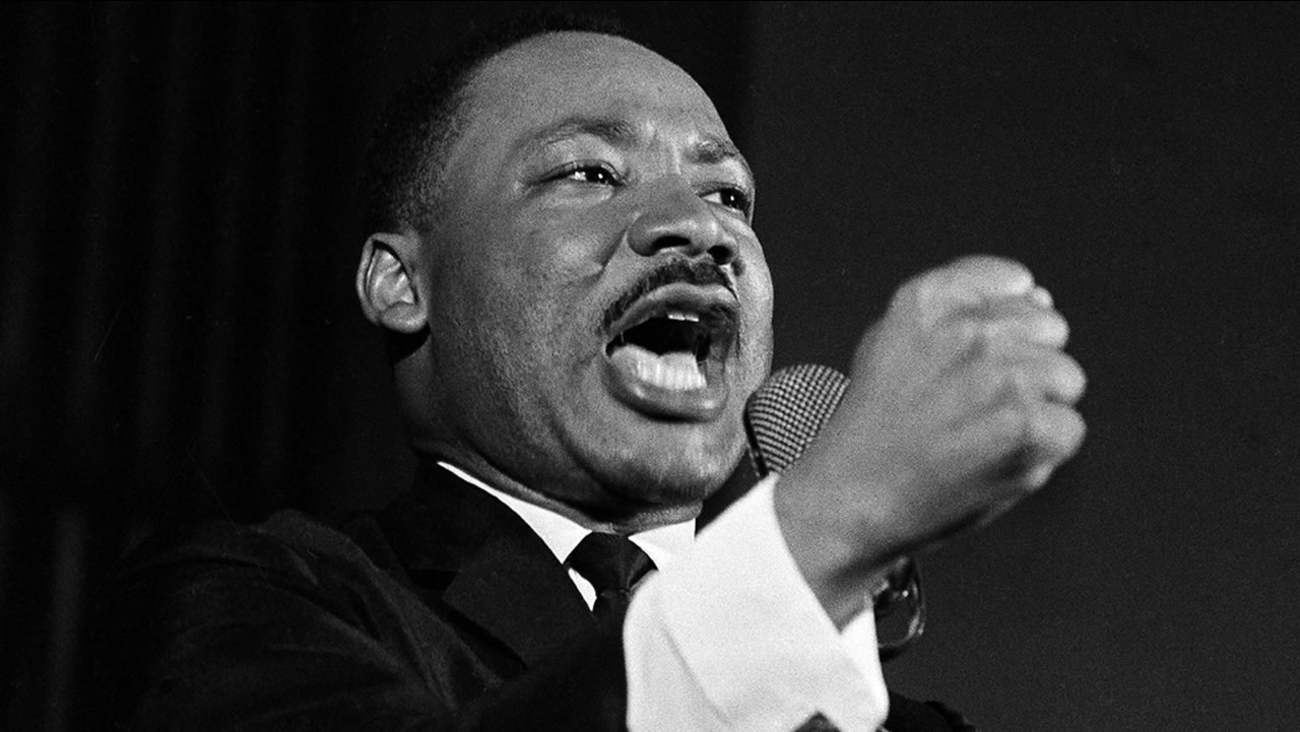 Dr. Martin Luther King Jr. shakes his fist during a speech in Selma, Ala., Feb. 12, 1965. (AP Photo/Horace Cort)