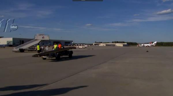 "<div class=""meta image-caption""><div class=""origin-logo origin-image wtvd""><span>WTVD</span></div><span class=""caption-text"">Airport employees wait to assist the Tar Heels</span></div>"