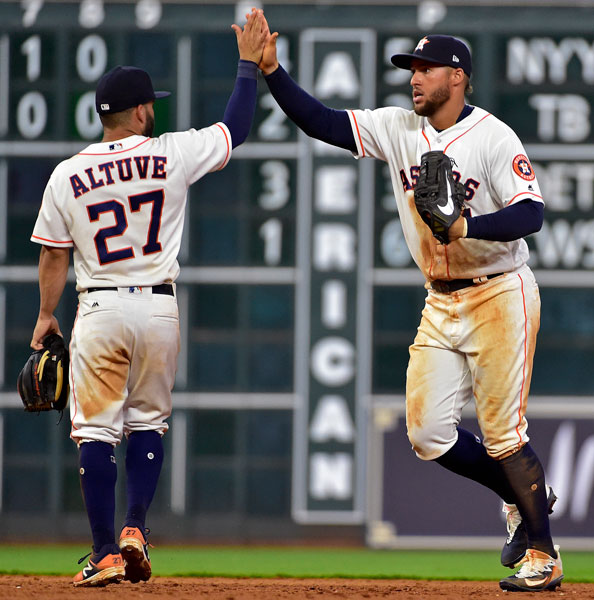 <div class='meta'><div class='origin-logo' data-origin='none'></div><span class='caption-text' data-credit='AP Photo/Eric Christian Smith'>Houston Astros' George Springer, right, and Jose Altuve celebrate the team's 2-1 win over the Seattle Mariners in a baseball game, Tuesday, April 4, 2017, in Houston.</span></div>